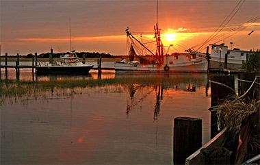 boats in the water in Folly Beach, South Carolina