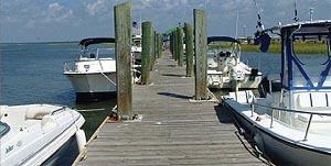 boats docked at a pier on Dewees Island, South Carolina